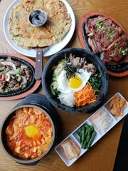 A spread of Korean fare from Jinji, a Korean restaurant and soju bar inside the New Seoul Plaza in Southfield.