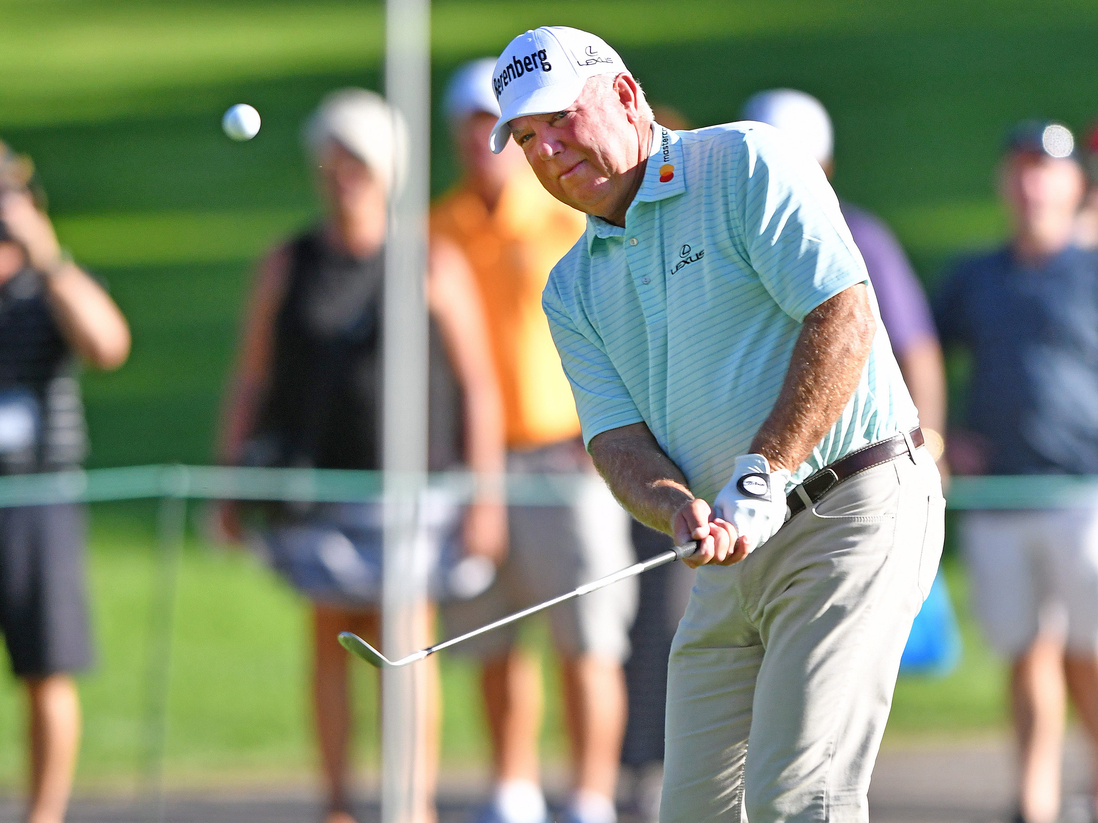 Mark O'Meara hits a chip shot on the 17th hole that rolls up next to it, but won't fall.