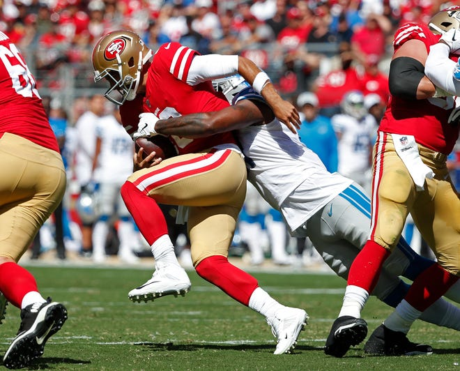 San Francisco 49ers quarterback Jimmy Garoppolo is sacked by the Detroit Lions' Eli Harold during the first half.
