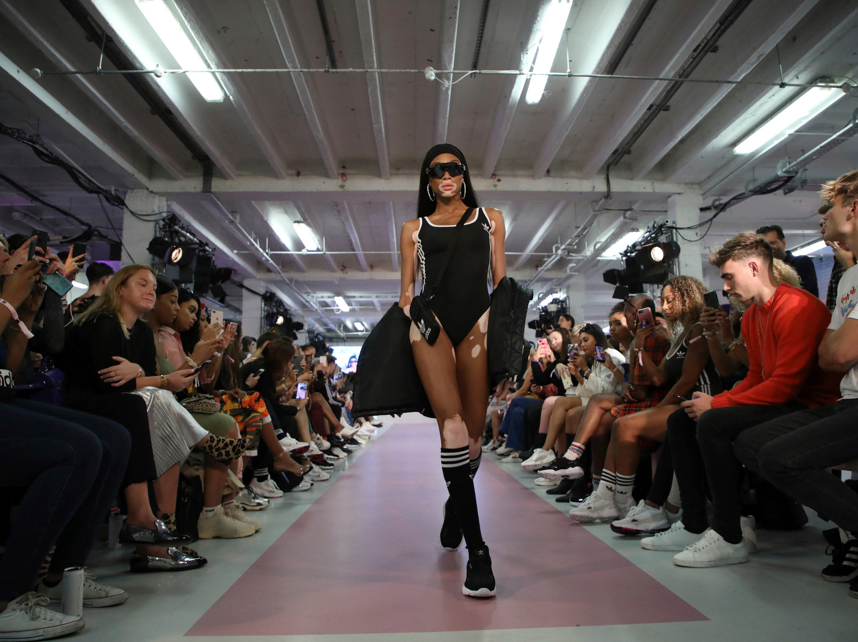 Model Winnie Harlow wears a creation by designer Hailey Baldwin for Adidas during their Spring/Summer 2019 runway show at London Fashion Week in London, Monday, Sept. 17, 2018.