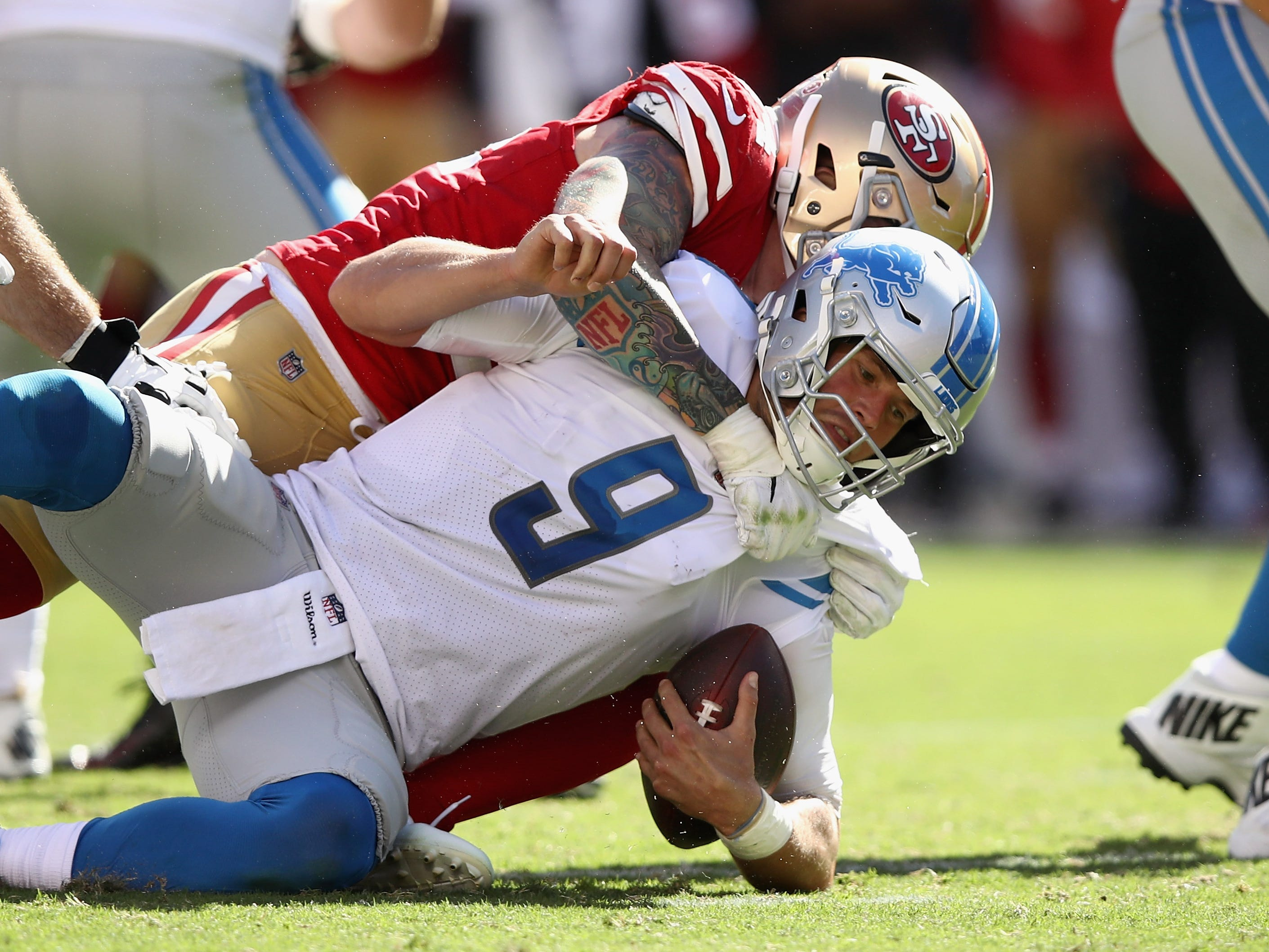 Lions quarterback Matthew Stafford is sacked by 49ers' Cassius Marsh.