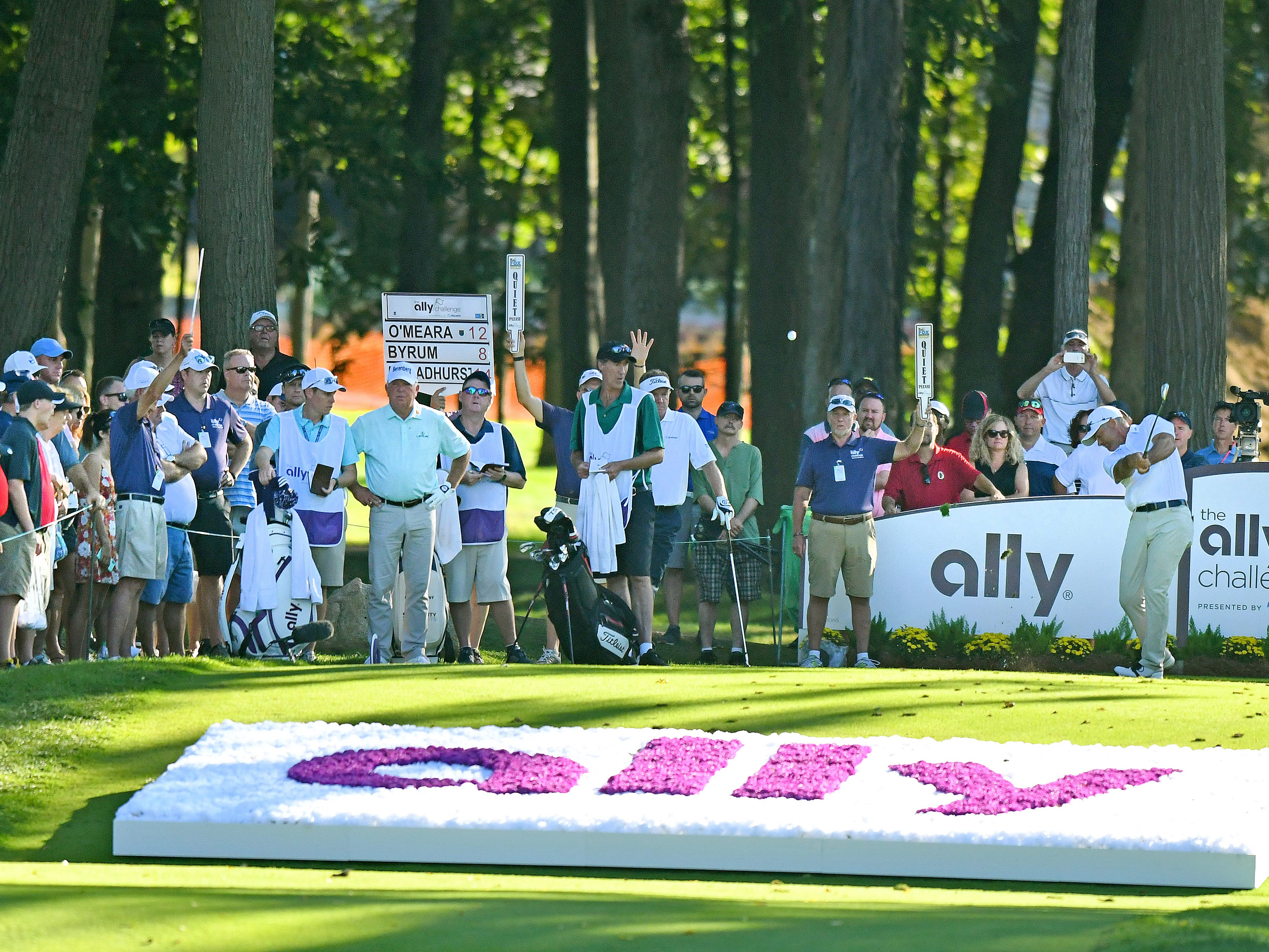 The gallery watches as Paul Broadhurst hits his tee shot on the 17th hole.