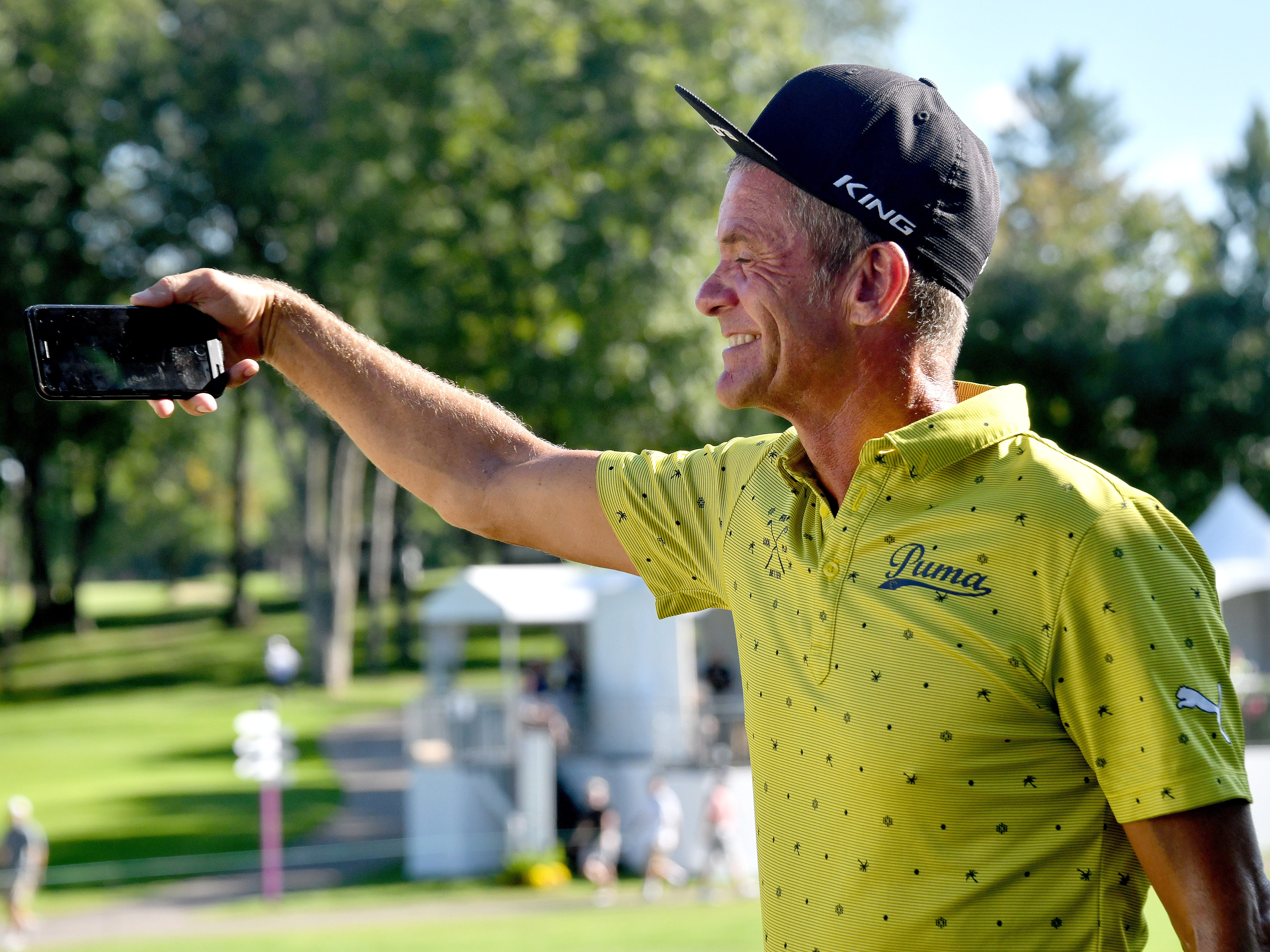 Jesper Parnevik shoots a selfie with the crowd on the 17th hole.