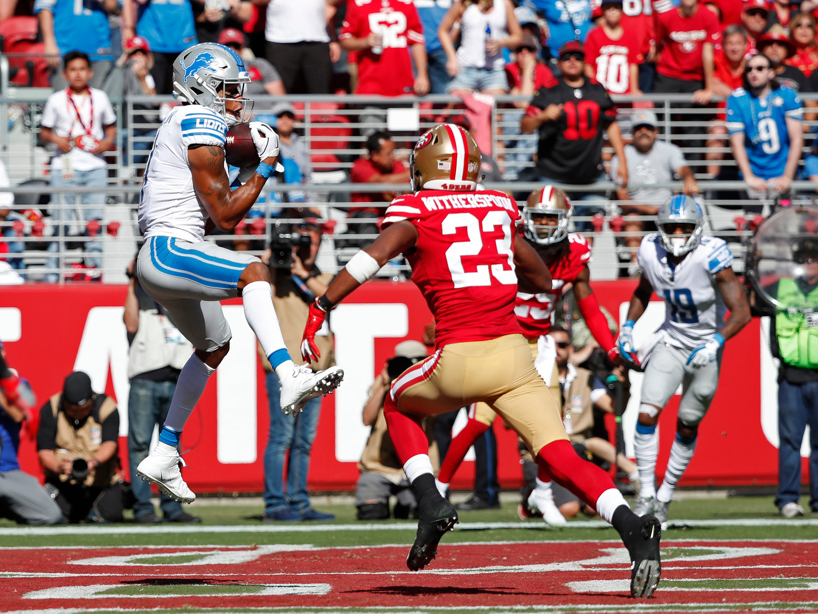 Detroit Lions wide receiver Marvin Jones Jr. catches the ball for a touchdown as San Francisco 49ers cornerback Ahkello Witherspoon looks on during the second half.