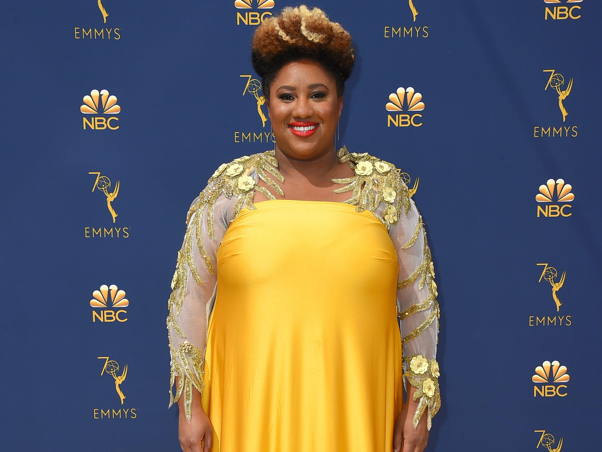 Ashley Nicole Black arrives at the 70th Primetime Emmy Awards on Monday, Sept. 17, 2018, at the Microsoft Theater in Los Angeles.