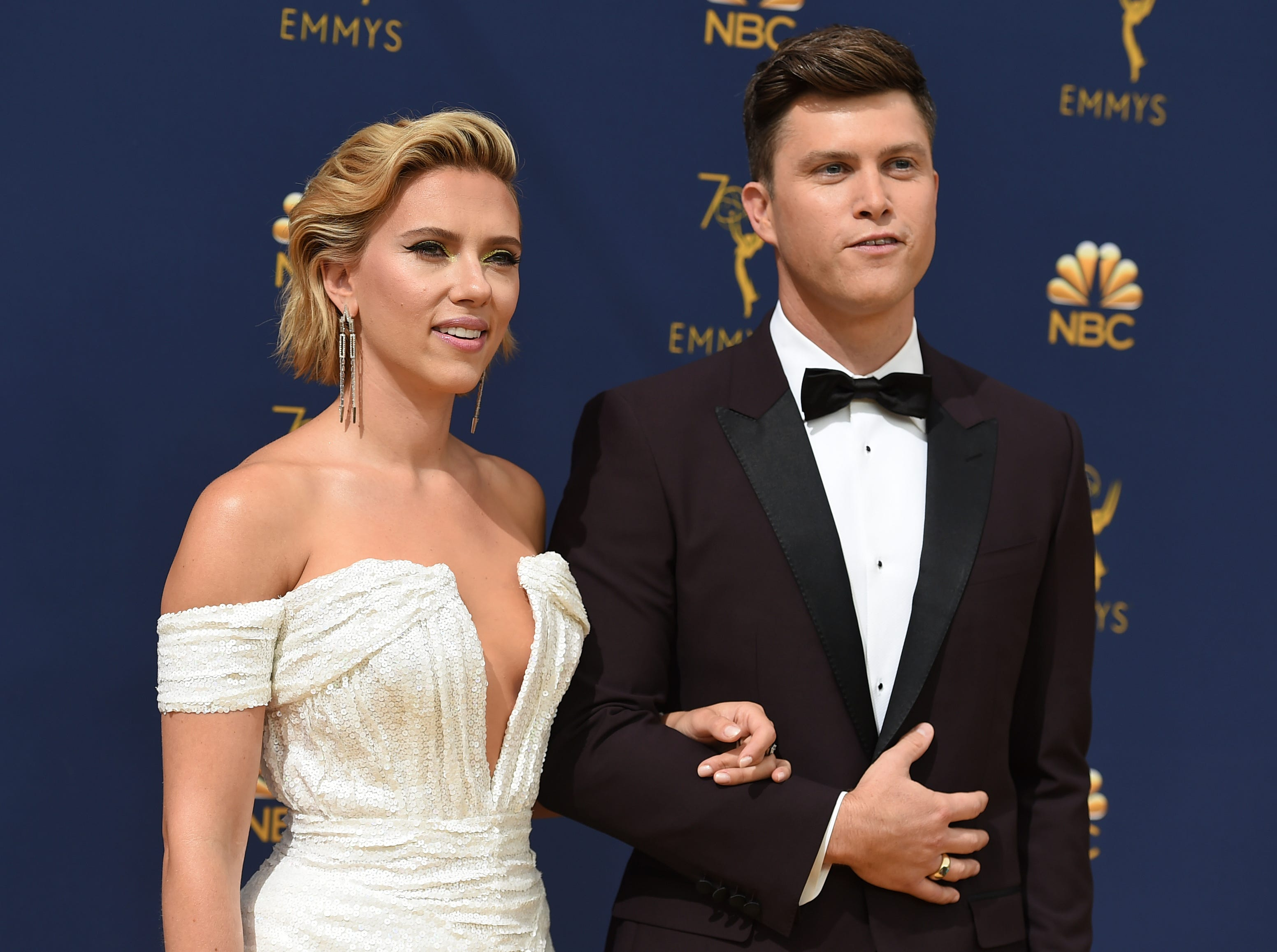 Scarlett Johansson, left, and Colin Jost arrive at the 70th Primetime Emmy Awards on Monday, Sept. 17, 2018, at the Microsoft Theater in Los Angeles.