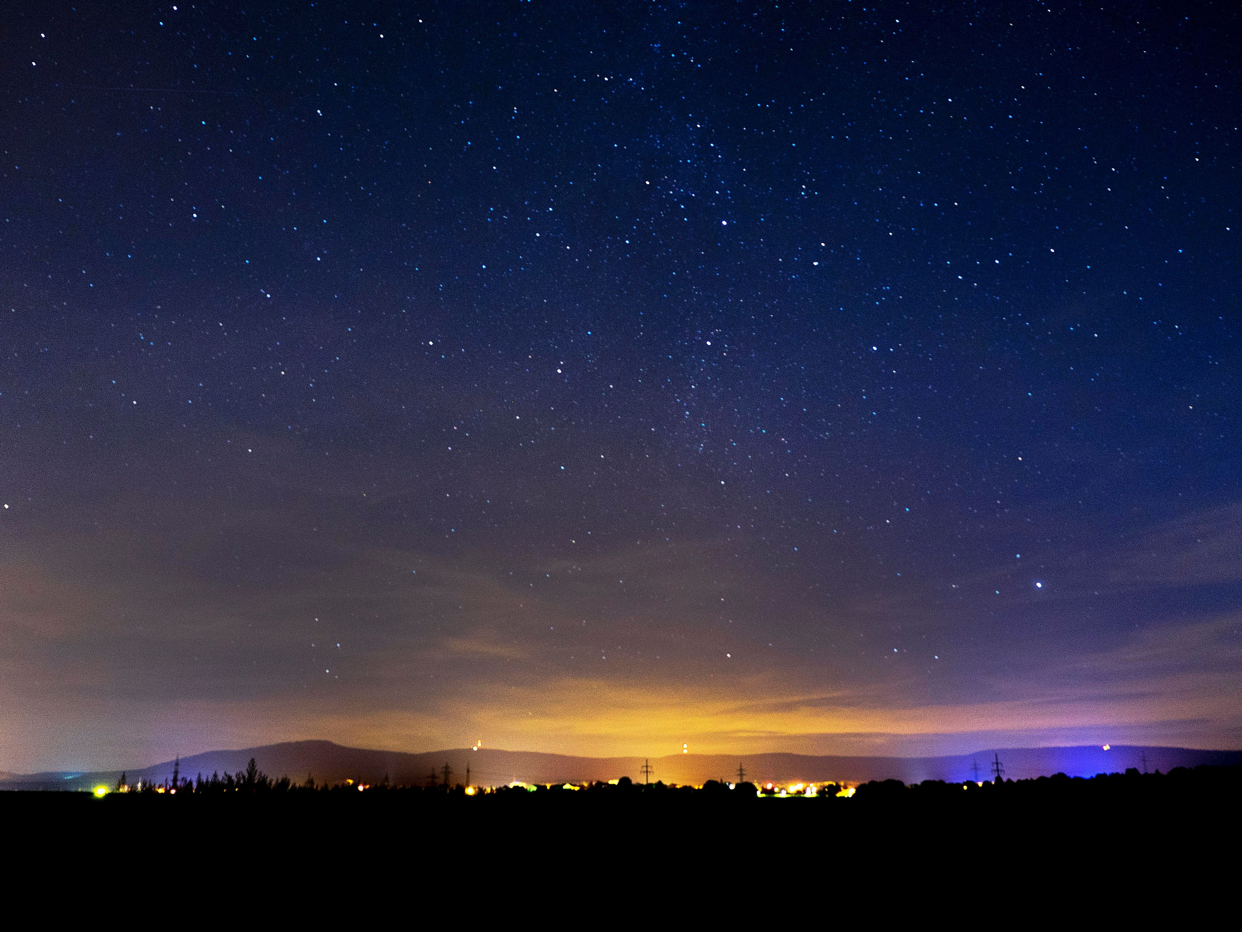 Stars shine over the hills of the Taunus region near Frankfurt, Germany, early Sunday, Sept. 16, 2018.