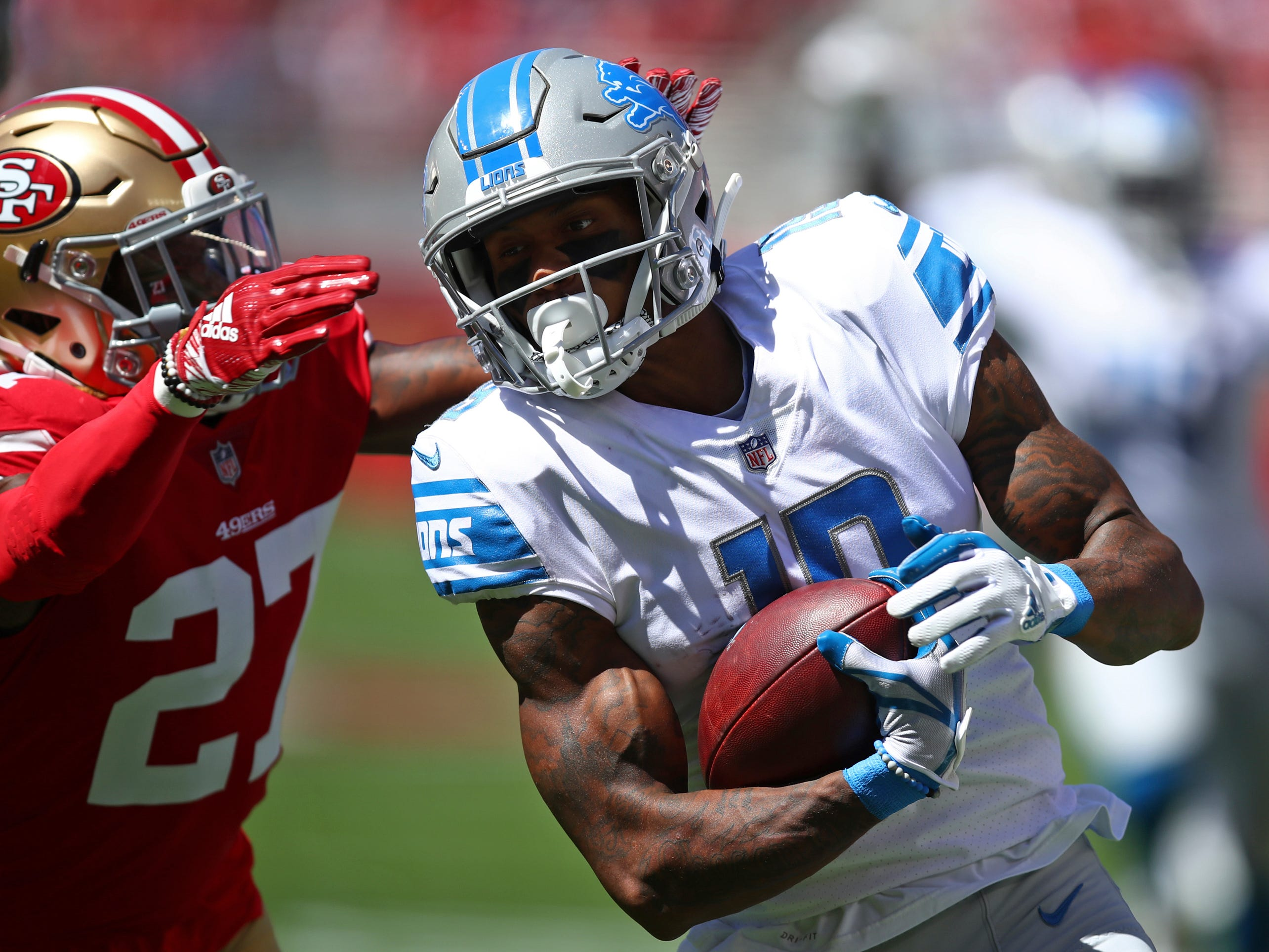 Detroit Lions wide receiver Kenny Golladay runs with the ball as San Francisco 49ers defensive back Adrian Colbert (27) looks on during the first half.
