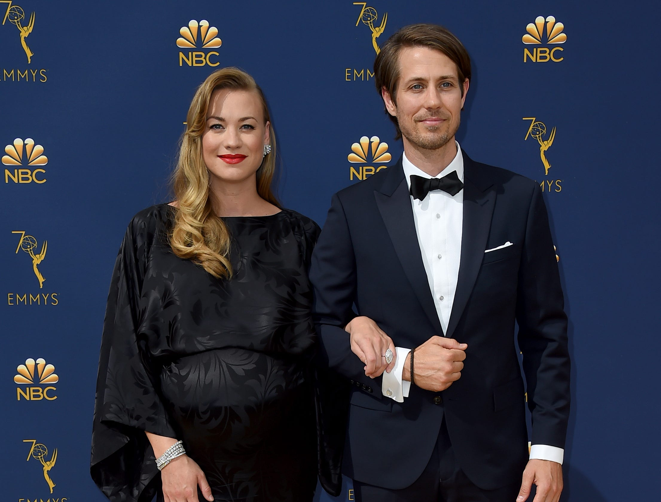 Yvonne Strahovski, left, and Tim Loden arrive at the 70th Primetime Emmy Awards on Monday, Sept. 17, 2018, at the Microsoft Theater in Los Angeles.