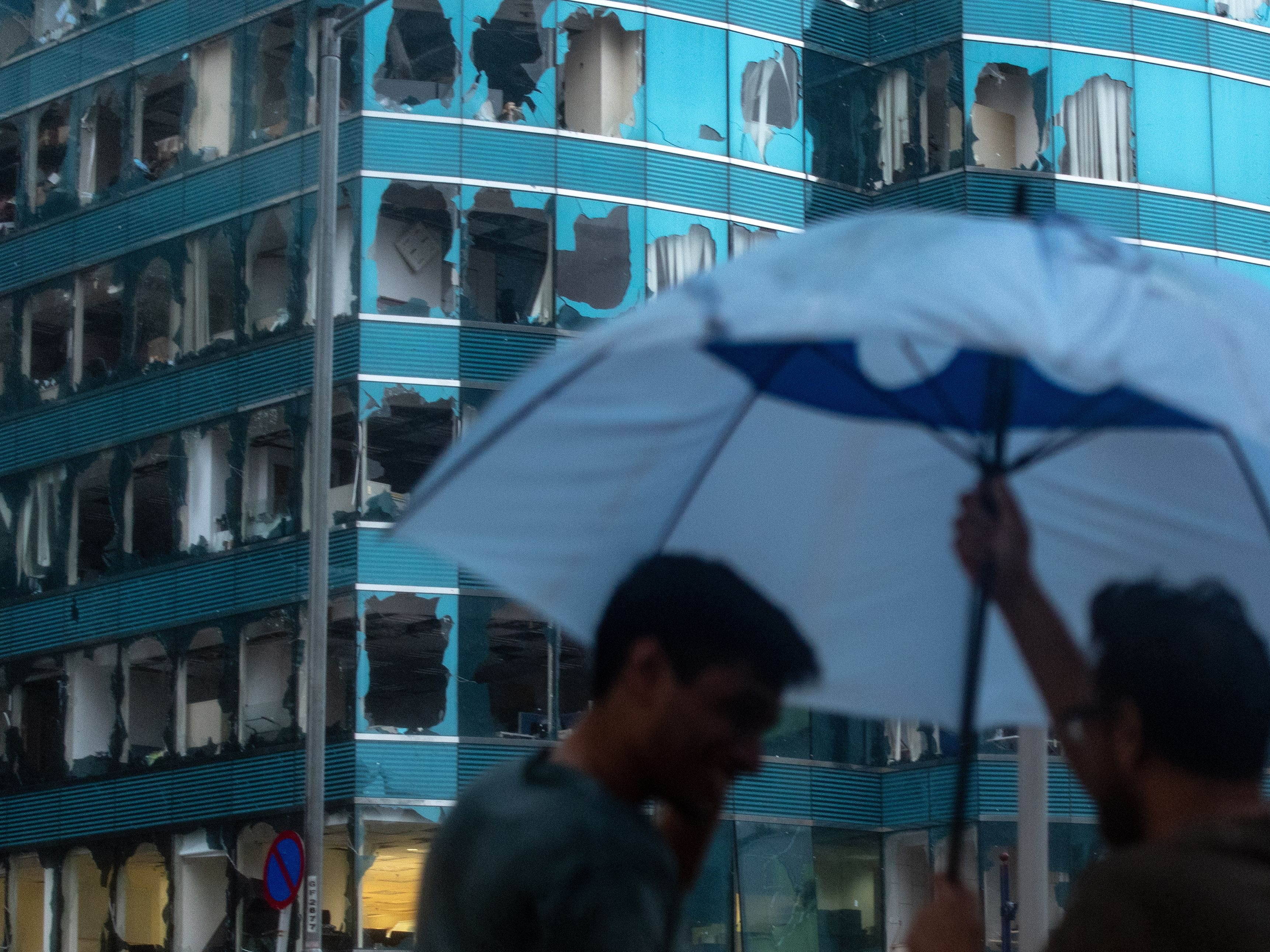 A general view shows windows of a commercial building smashed during Super Typhoon Mangkhut in Hong Kong on Sept. 16, 2018.