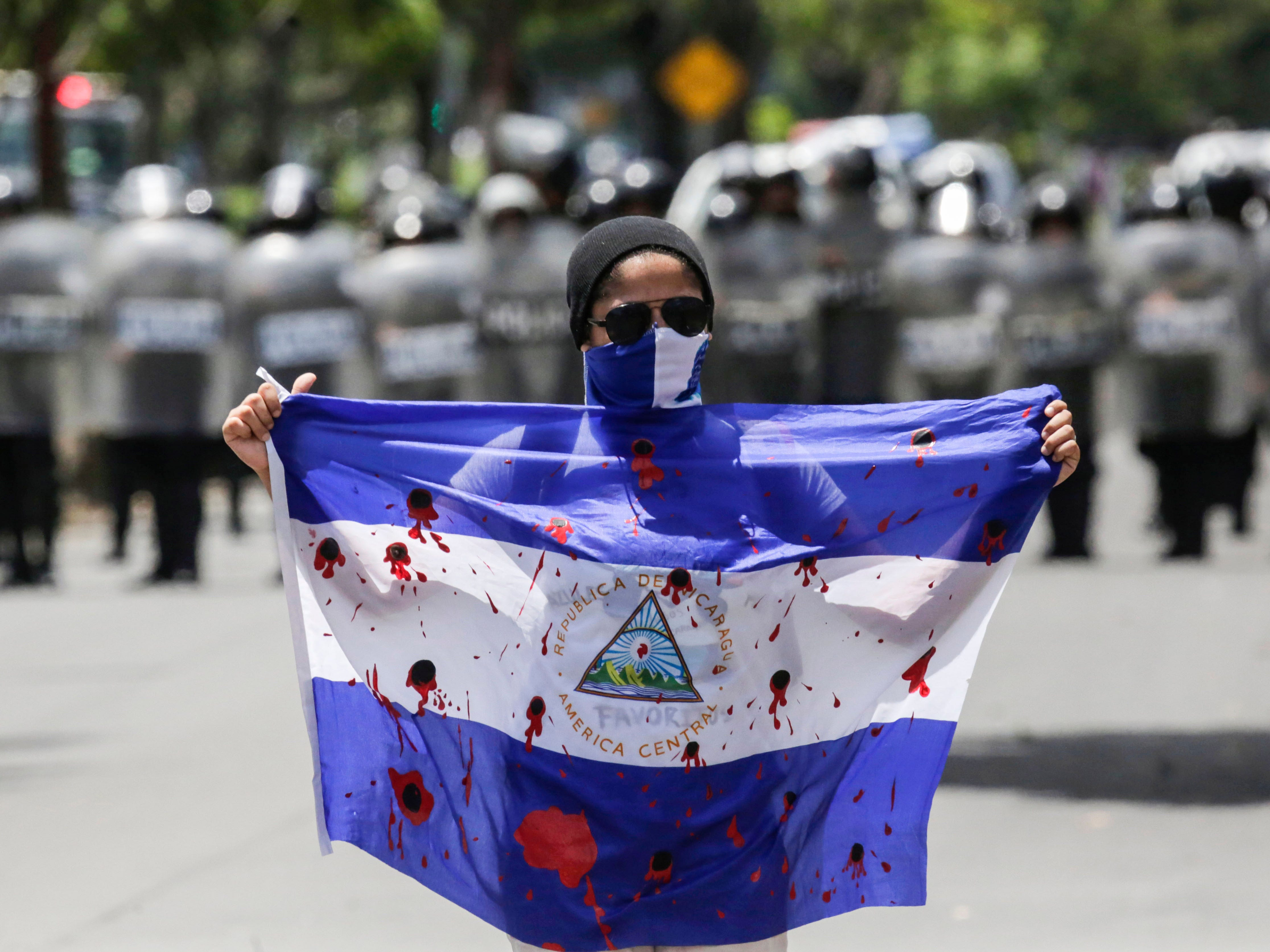 A demonstrator shows a bloody flag during a protest against Nicaraguan President Daniel Ortega's government in Managua, on Sept. 16, 2018.