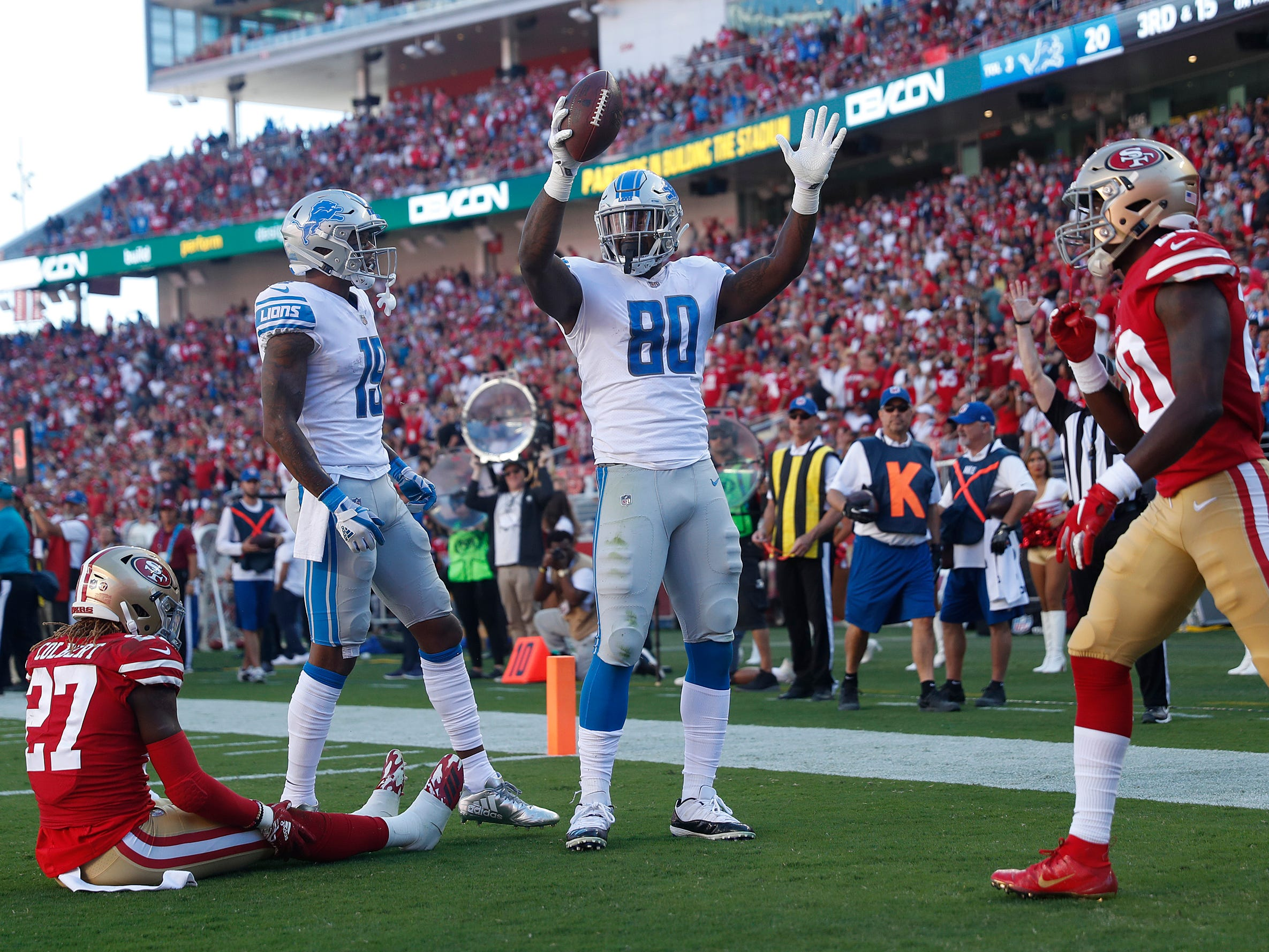 Detroit Lions tight end Michael Roberts celebrates after scoring a touchdown as San Francisco 49ers defensive back Adrian Colbert (27) and Jimmie Ward, right look on during the second half.