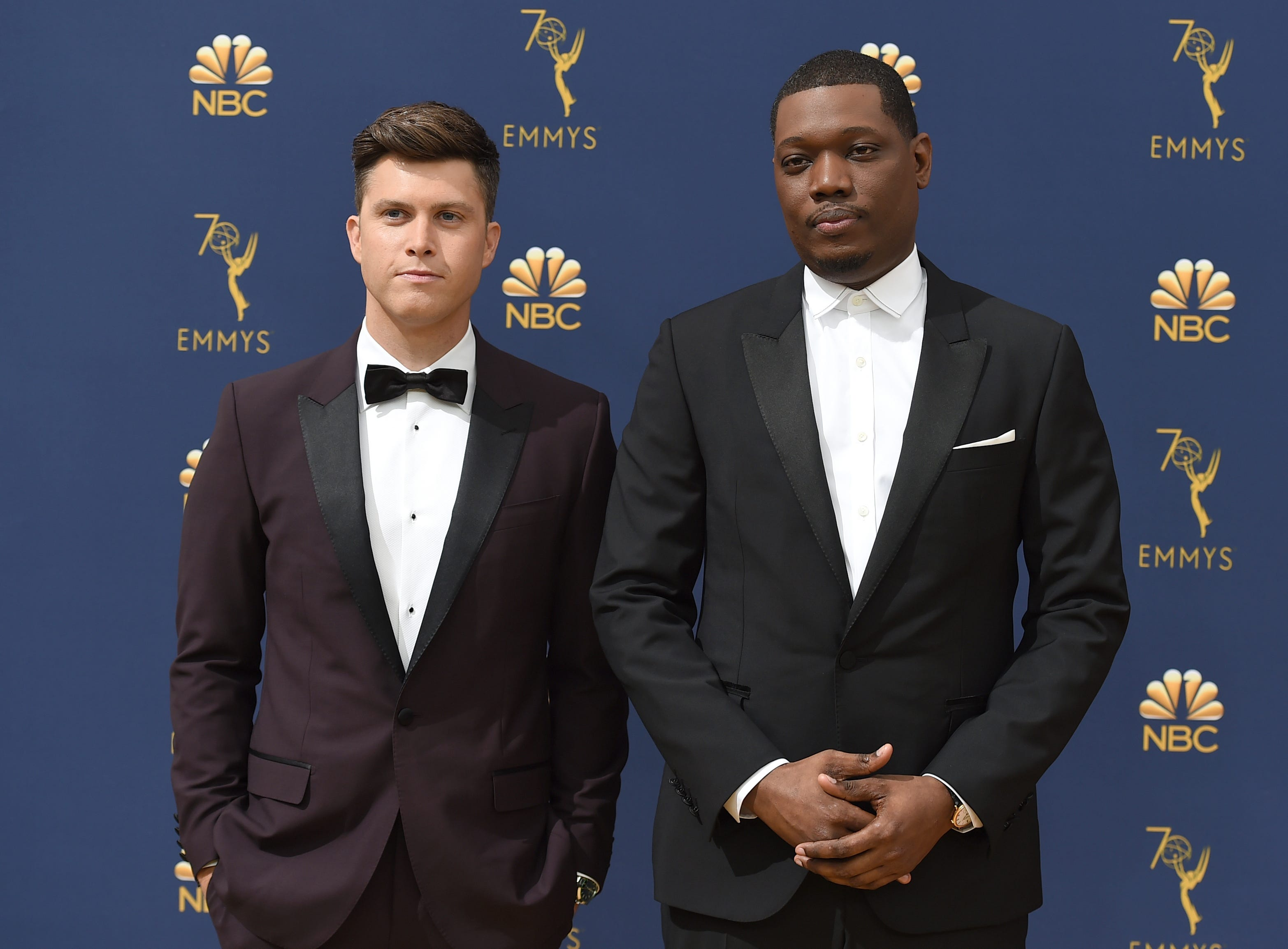 Colin Jost, left, and Michael Che arrive at the 70th Primetime Emmy Awards on Monday, Sept. 17, 2018, at the Microsoft Theater in Los Angeles. (Photo by Jordan Strauss/Invision/AP)