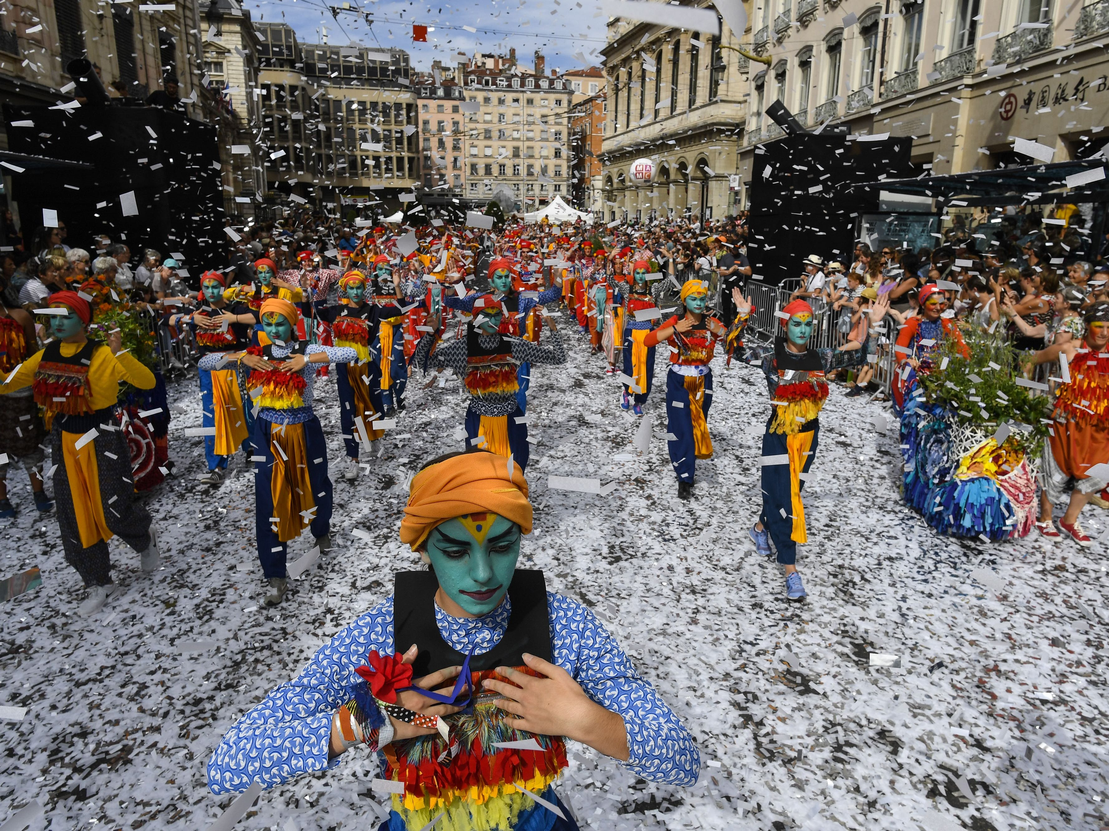 Dancers perform during a parade on the theme of peace for the 18th edition of the Lyon Dance Biennial on a street in Lyon, eastern France on September 16, 2018.