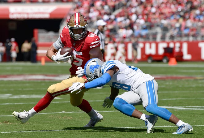 San Francisco 49ers tight end George Kittle fights off the tackle of Lions defensive back Quandre Diggs during the second quarter Sunday in Santa Clara, Cailf. On a separate play Diggs was called for a defensive holding penalty in the fourth quarter.