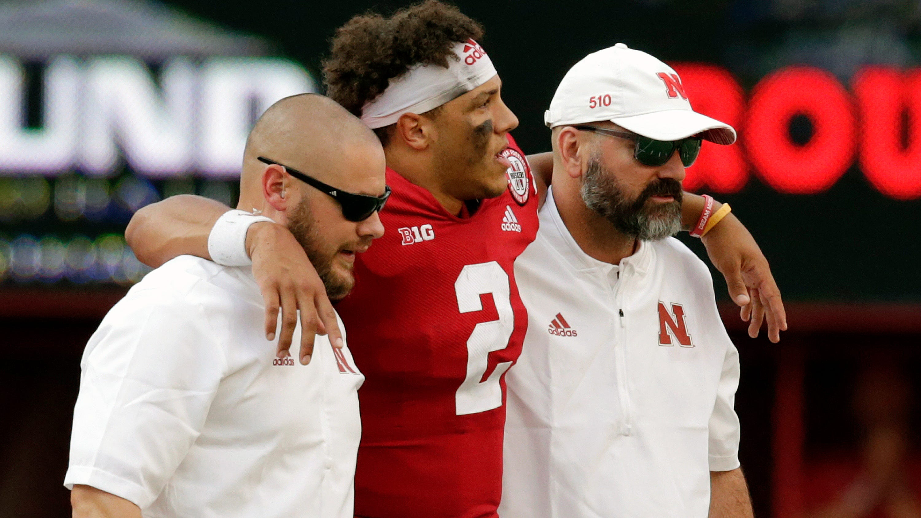 Nebraska trainers help injured quarterback Adrian Martinez (2) off the field during the second half Sept. 8 against Colorado in Lincoln, Neb. Martinez could be a game-time decision for Nebraska on Saturday against Michigan.