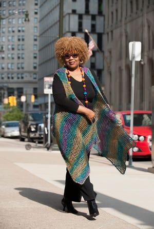 Detroit News columnist Jocelynn Brown models her handmade full-length vest. Photos taken on Friday, September 14, 2018.
