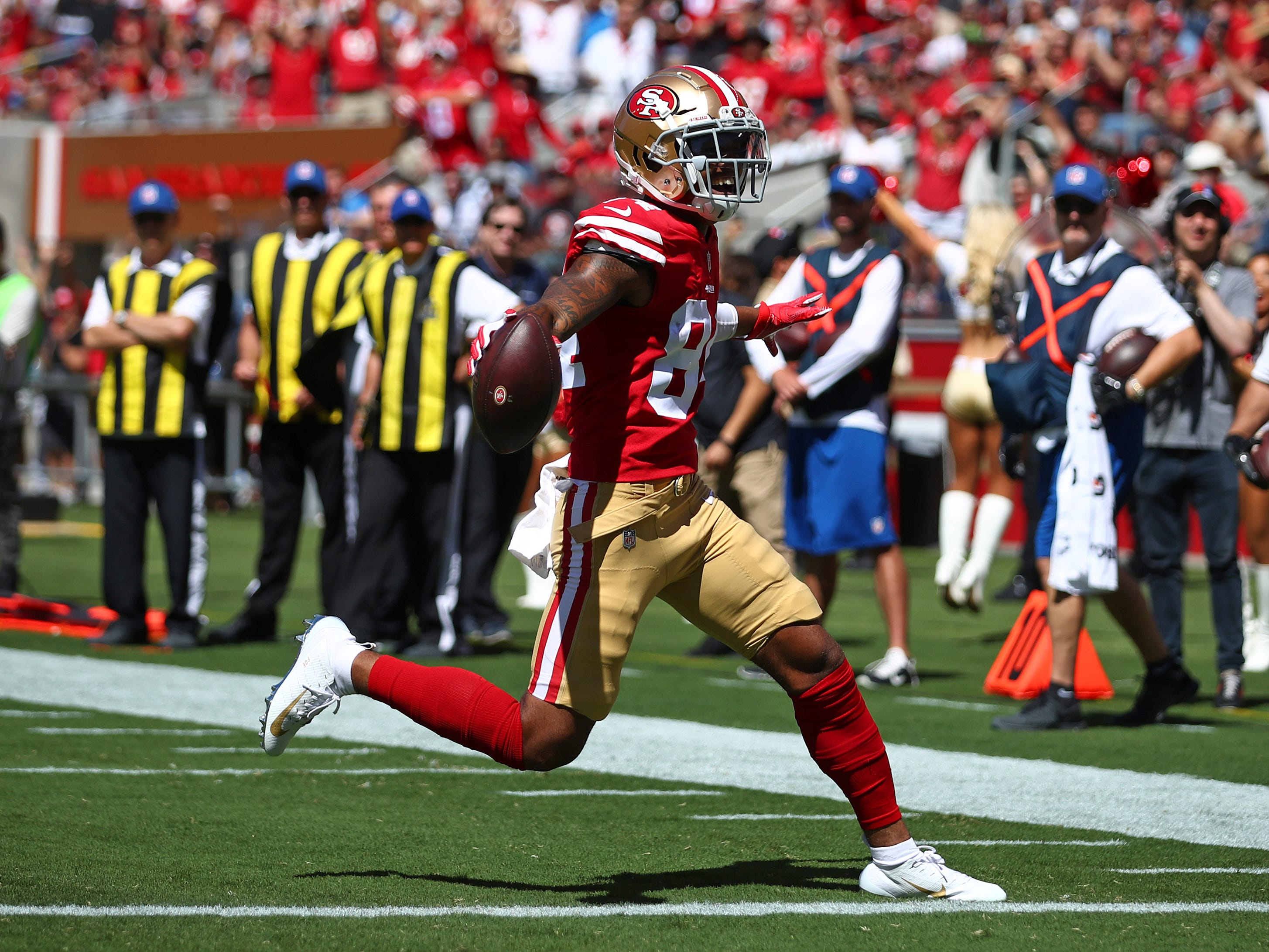 San Francisco 49ers wide receiver Kendrick Bourne carries the ball into the end zone for a touchdown during the first half.