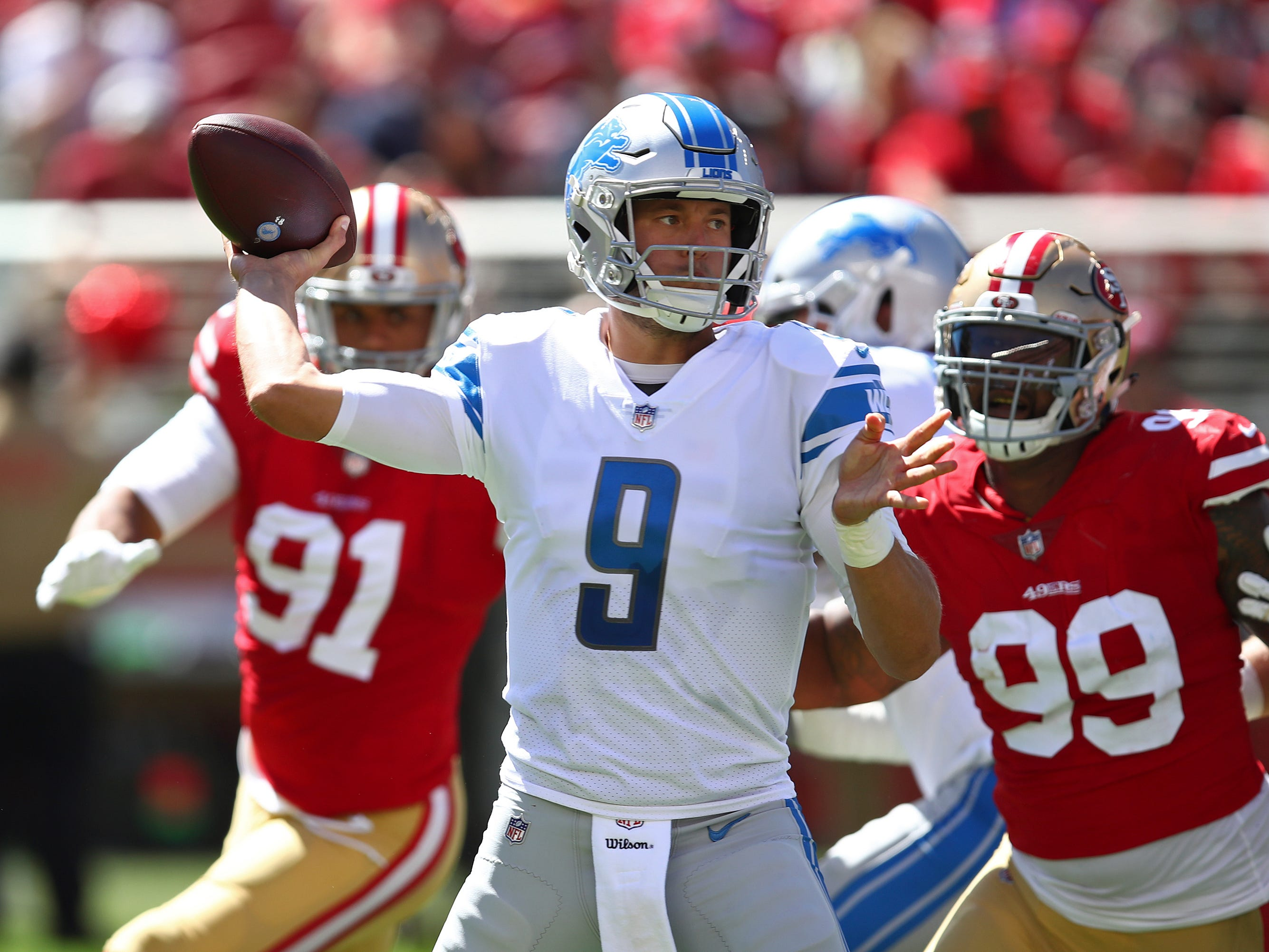 Detroit Lions quarterback Matthew Stafford (9) looks to throw as San Francisco 49ers defensive ends Arik Armstead (91) and DeForest Buckner (99) look on during the first half.