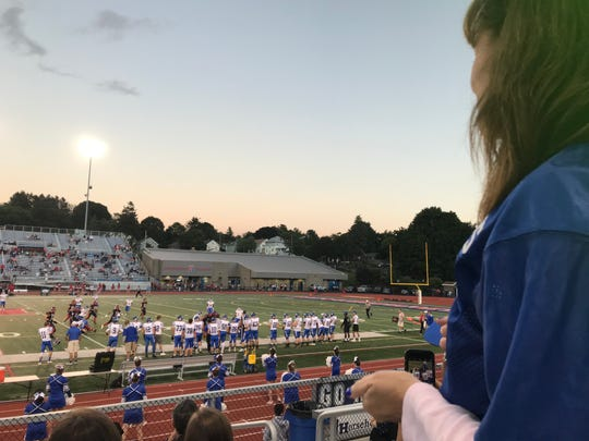 Kathy Rohan watches her son, Billy, play at a football game at Alumni Stadium.