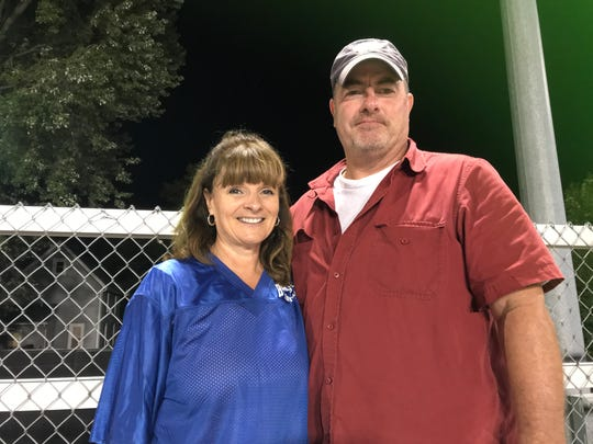 Kathy and Kevin Rohan watch their son, Billy, play at Alumni Stadium in Binghamton Friday.
