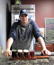 Time flies... proud new business papa, Jason Carson in January of 2014. The list of beer offerings has grown quite a bit since the original eight listed in on the board in the background