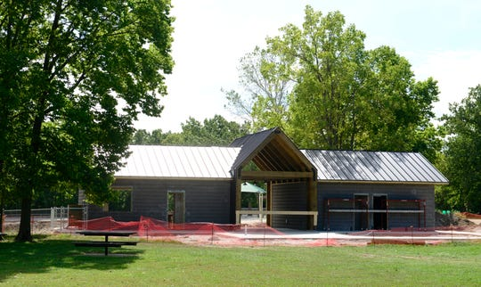 A new building by the quarry at White Star Park is part of the $1.3 million project for four new buildings: new restrooms at the campground, scuba, barn and beach areas, with an ADA-accessible shower at the campground, and a concession area on the beach.