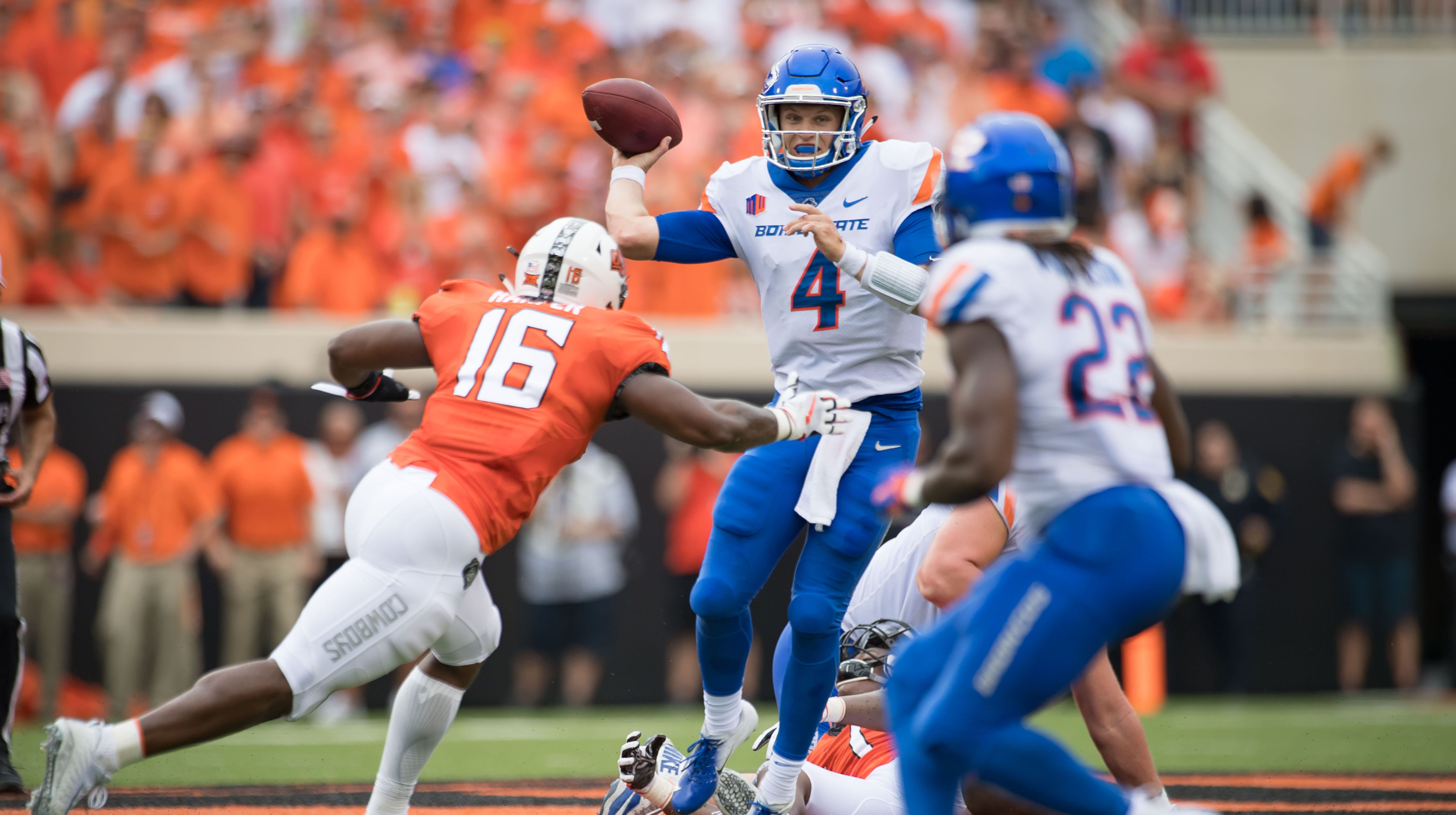 Sep 15, 2018; Stillwater, OK, USA; Boise State Broncos quarterback Brett Rypien (4) drops back to pass while defended by Oklahoma State Cowboys linebacker Devin Harper (16) during the first half at Boone Pickens Stadium. Mandatory Credit: Rob Ferguson-USA TODAY Sports