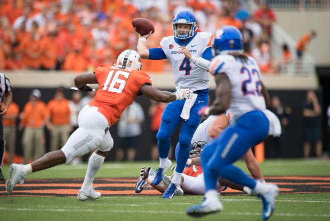 Boise State quarterback Brett Rypien (4) drops back to pass against Oklahoma State on Saturday.