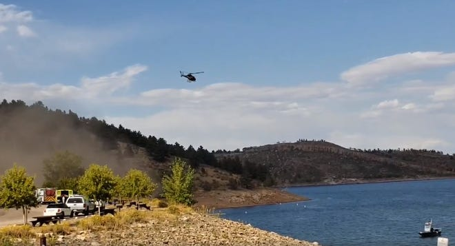 "Crews pulled an unresponsive man from Horsetooth Reservoir Monday afternoon after a witness said he was swimming and then ""didn't come back up."""