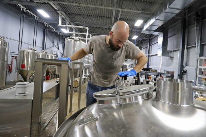 Badger State Brewing's head cellarman Brian Jacobs inspects the new 7-barrel brewing system being installed as the Green Bay brewery prepares to ramp up production.
