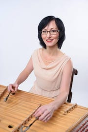 Tatyana Krasnobaeva joins Stas Venglevski on the cimbalom, an Eastern European form of the dulcimer, in a Sept. 23 concert at the Holiday Music Motel's Tambourine Lounge.