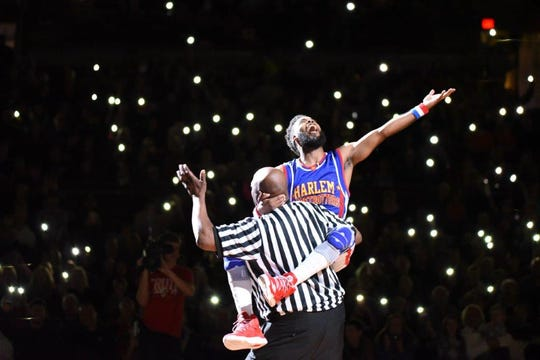 Ant Atkinson of the Harlem Globetrotters has some fun on tour.