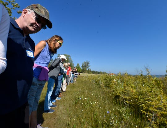 Attendees of the Orchid Symposium stop along a trail at The Ridges Sanctuary in Baileys Harbor in an effort to spot a small orchid called Nodding Ladies Tresses near the shores of Lake Michigan on Friday, Sept. 14, 2018. Tina M. Gohr/USA TODAY NETWORK-Wisconsin