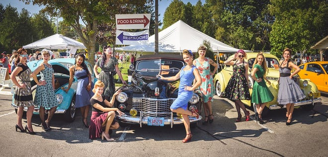 Models strike a pose in front of some of the classic vehicles at last year's Pin Ups & Pistons car and motorcycle show, part of Autumnfest in Baileys Harbor. This year's festival and show take place Sept. 22.
