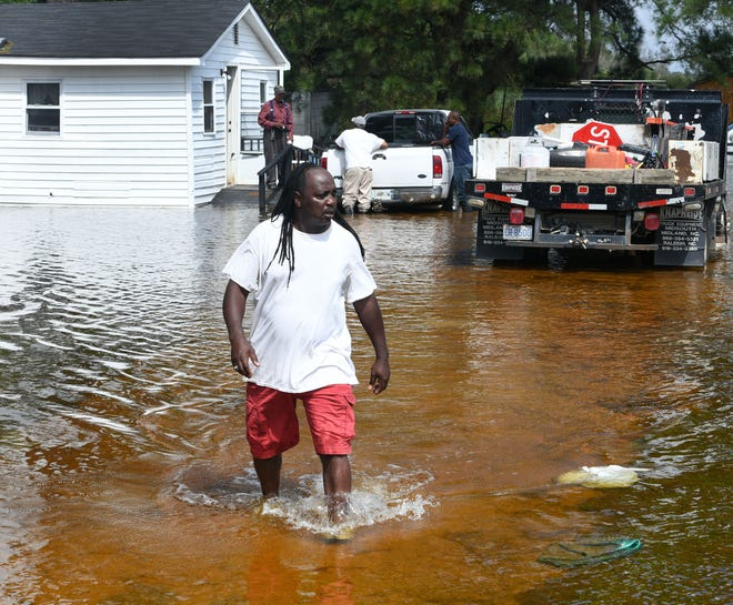 Billy McGirt in Latta, NC walks away after checking on his father who was stranded in his home when flood waters rose from Hurricane Florence Monday, September 17, 2018.