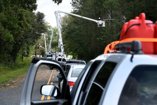 Travelers stranded while utility crews repair lines and poles outside Wilmington following Hurricane Florence Monday, September 17, 2018.