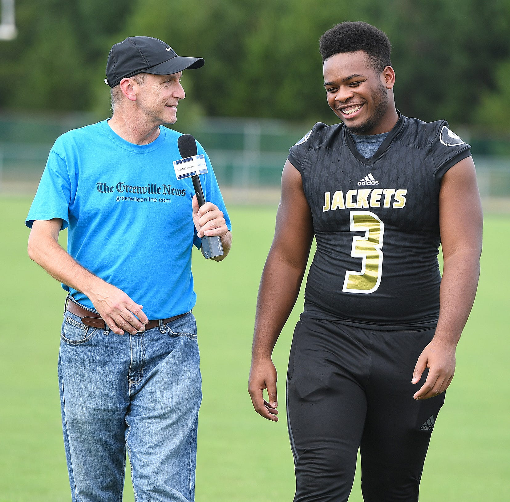 "The Greenville News' Bob Castello walks 100 Yards with Greer's Quantavious ""Quack"" Cohen."