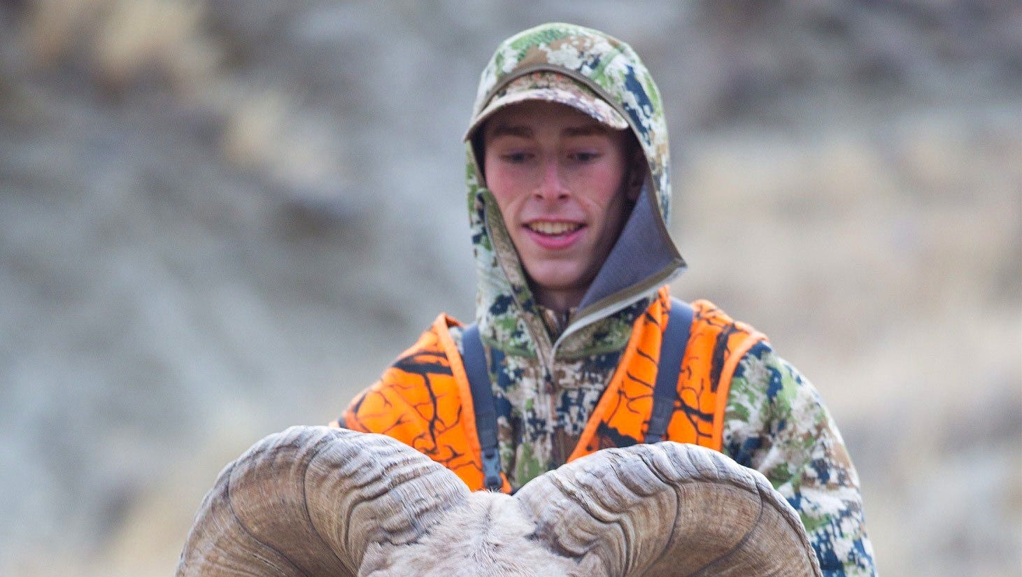 Justin Sheedy holds the horns of the bighorn sheep he shot last October while hunting in the Missouri River Breaks. The ram has scored 208 3/8, good enough to tie the current world record hunter-shot ram based on the Boone and Crockett Club scoring system.