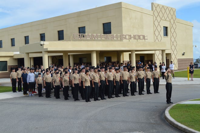 On September 17th, Guam High School and its NJROTC cadets raise colors to commemorate the 17th anniversary of 9/11.  The ceremony was held a week after Typhoon Mangkhut. Leading the NJROTC company, is Cadet Commander John Danieli.