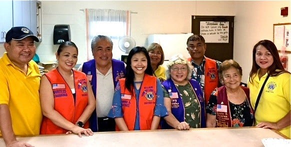 In support of Lions Clubs International's initiative of alleviating world-wide hunger, LCI District 204 is providing two homeless feedings per month. On August 28 the Harmony Lions Club provided meals for 130 individuals at the Dededo center. Pictured from left: Lions William Sevillo, Marites Barrogo, Cruz, Jemimah Martinez,RoseMarie Matsunaga, Ewy Taitano, Dr. Roger Martinez, Rosie Fejeran, and Beverly Dorion.