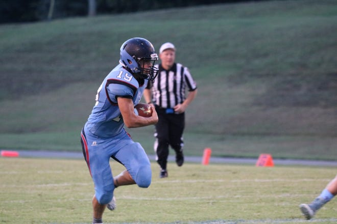 Union County's Lincoln Sisk runs the ball down the field during Friday's 59-14 win over Ballard Memorial at Union County High School's Baker Field.