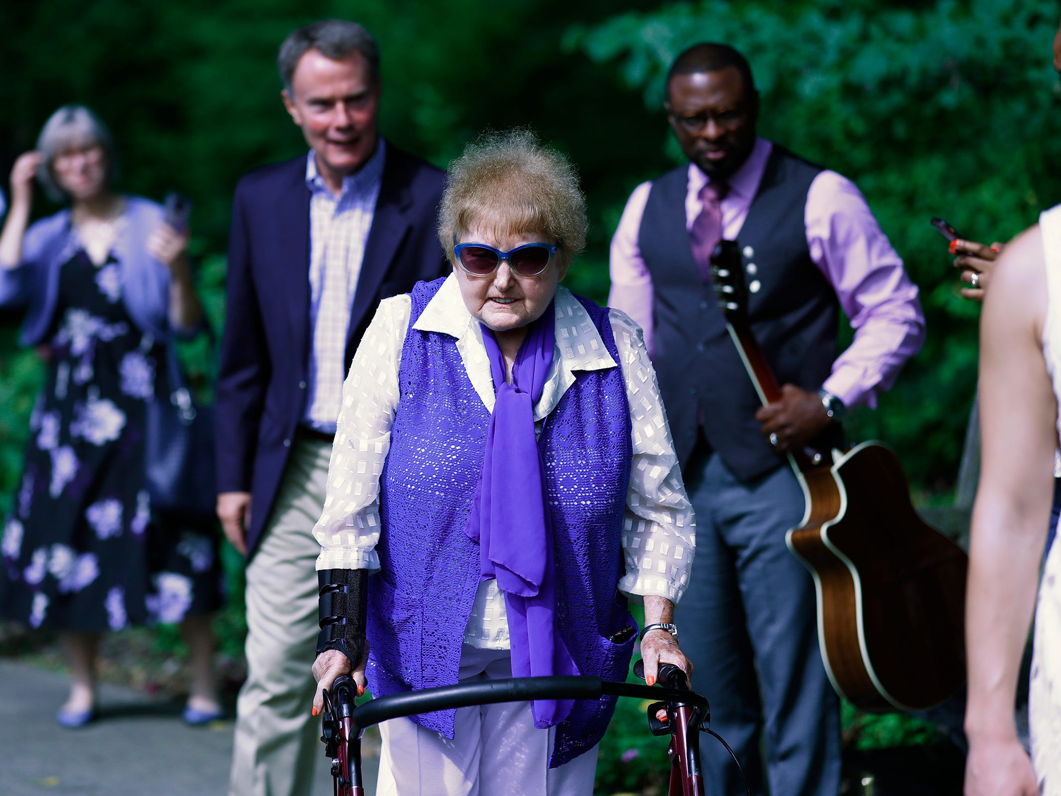 """Holocaust survivor Eva Kor walks with others to the planting of the Eva Kor Peace Garden at Newfields, Monday, Sept. 17, 2018.  Students viewed the documentary """"Eva,"""" about Kor, and then they helped in the planting of the Peace Garden.  Kor also spoke with the students, asking them to think of one thing to make the world better."""