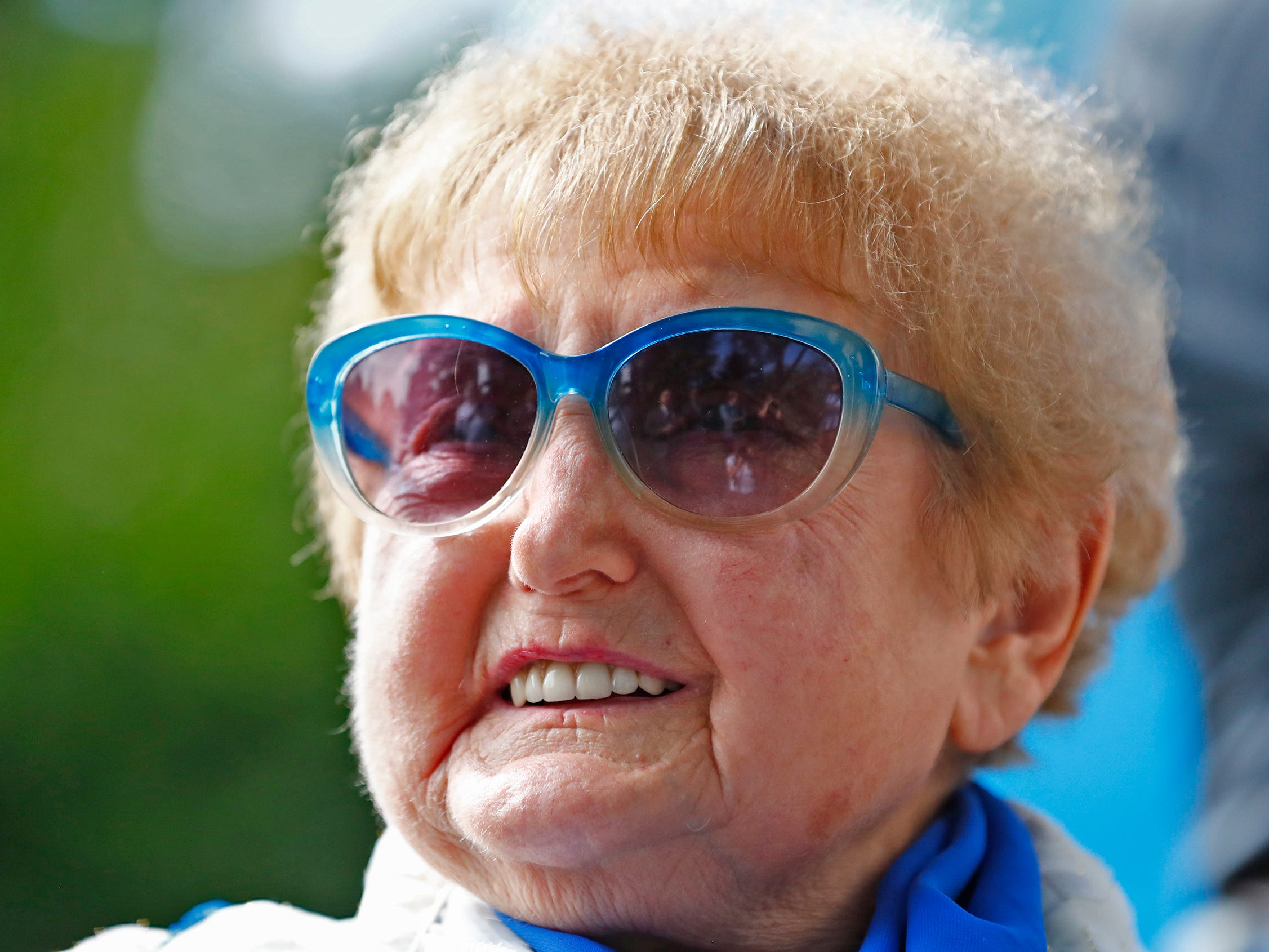 """Holocaust survivor Eva Kor smiles during the planting of the Eva Kor Peace Garden at Newfields, Monday, Sept. 17, 2018.  Students viewed the documentary """"Eva,"""" about Holocaust survivor Eva Kor, and then helped in the planting of the Peace Garden.  Kor also spoke with the students, asking them to think of one thing to make the world better."""