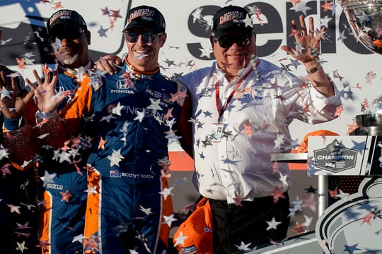 Sep 16, 2018; Sonoma, CA, USA;  Indycar driver Scott Dixon (9) celebrates with owner Chip Ganassi at the Grand Prix of Sonoma ceremony at Sonoma Raceway. Mandatory Credit: Stan Szeto-USA TODAY Sports