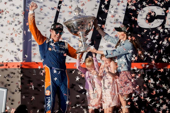 Sep 16, 2018; Sonoma, CA, USA;  Indycar driver Scott Dixon (9) celebrates with his family at the Grand Prix of Sonoma ceremony at Sonoma Raceway. Mandatory Credit: Stan Szeto-USA TODAY Sports