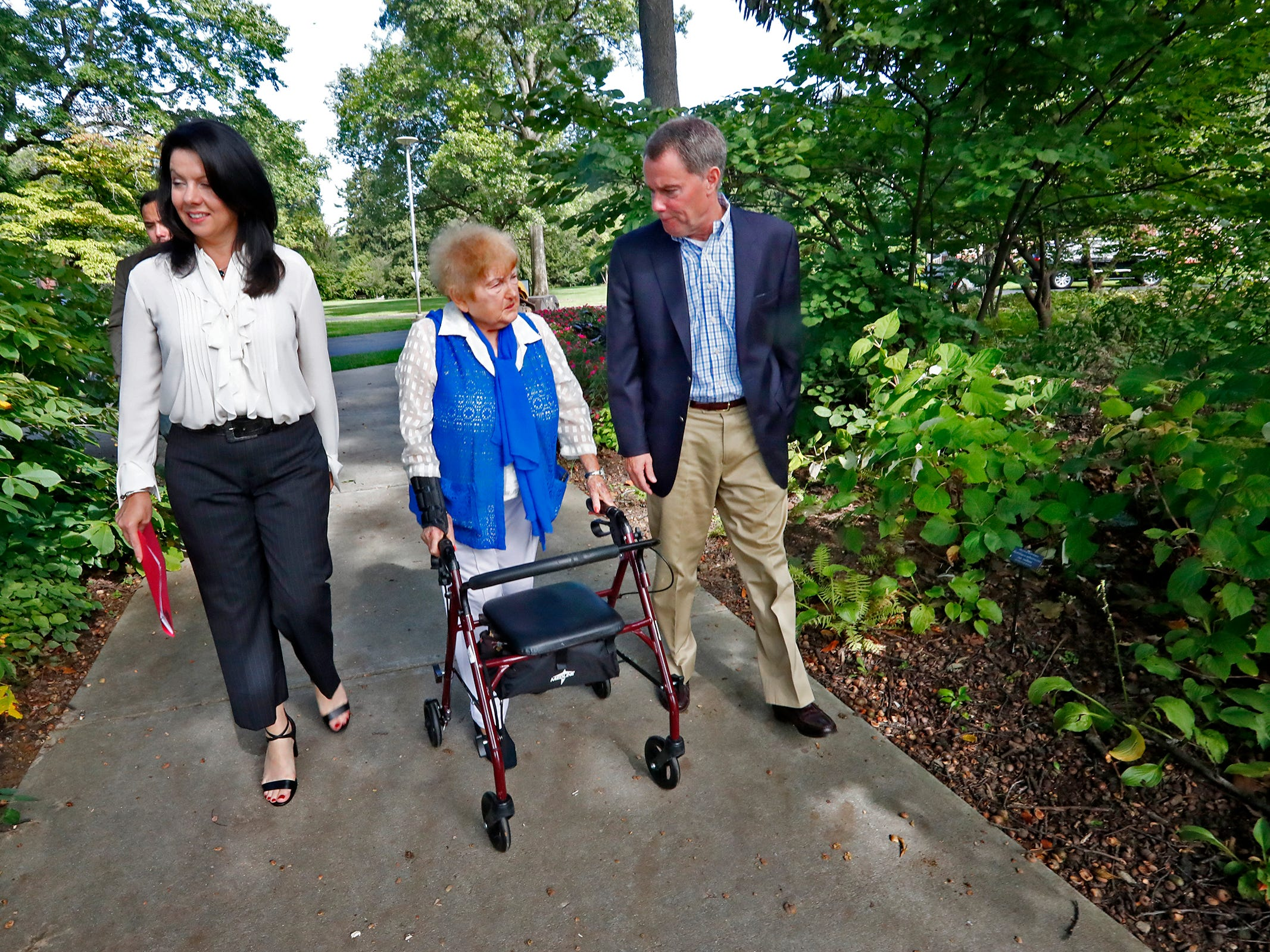 """Eva Kor, center, walks with Indiana First Lady Janet Holcomb and Mayor Joe Hogsett, heading to the Eva Kor Peace Garden at Newfields, Monday, Sept. 17, 2018.  Students viewed the documentary """"Eva,"""" about  Holocaust survivor Eva Kor, and then helped in the planting of the Peace Garden.  Kor also spoke with the students, asking them to think of one thing to make the world better."""