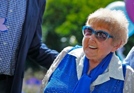 Holocaust survivor Eva Kor smiles during the planting of the Eva Kor Peace Garden at Newfields, Monday, Sept. 17, 2018.