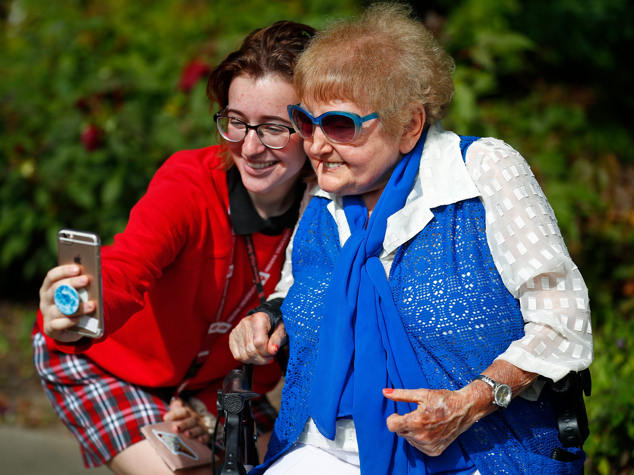 """Herron High School student Anya Heminger, left, takes a selfie with Holocaust survivor Eva Kor during the planting of the Eva Kor Peace Garden at Newfields, Monday, Sept. 17, 2018.  Students viewed the documentary """"Eva,"""" about Kor, and then they helped in the planting of the Peace Garden.  Kor also spoke with the students, asking them to think of one thing to make the world better."""