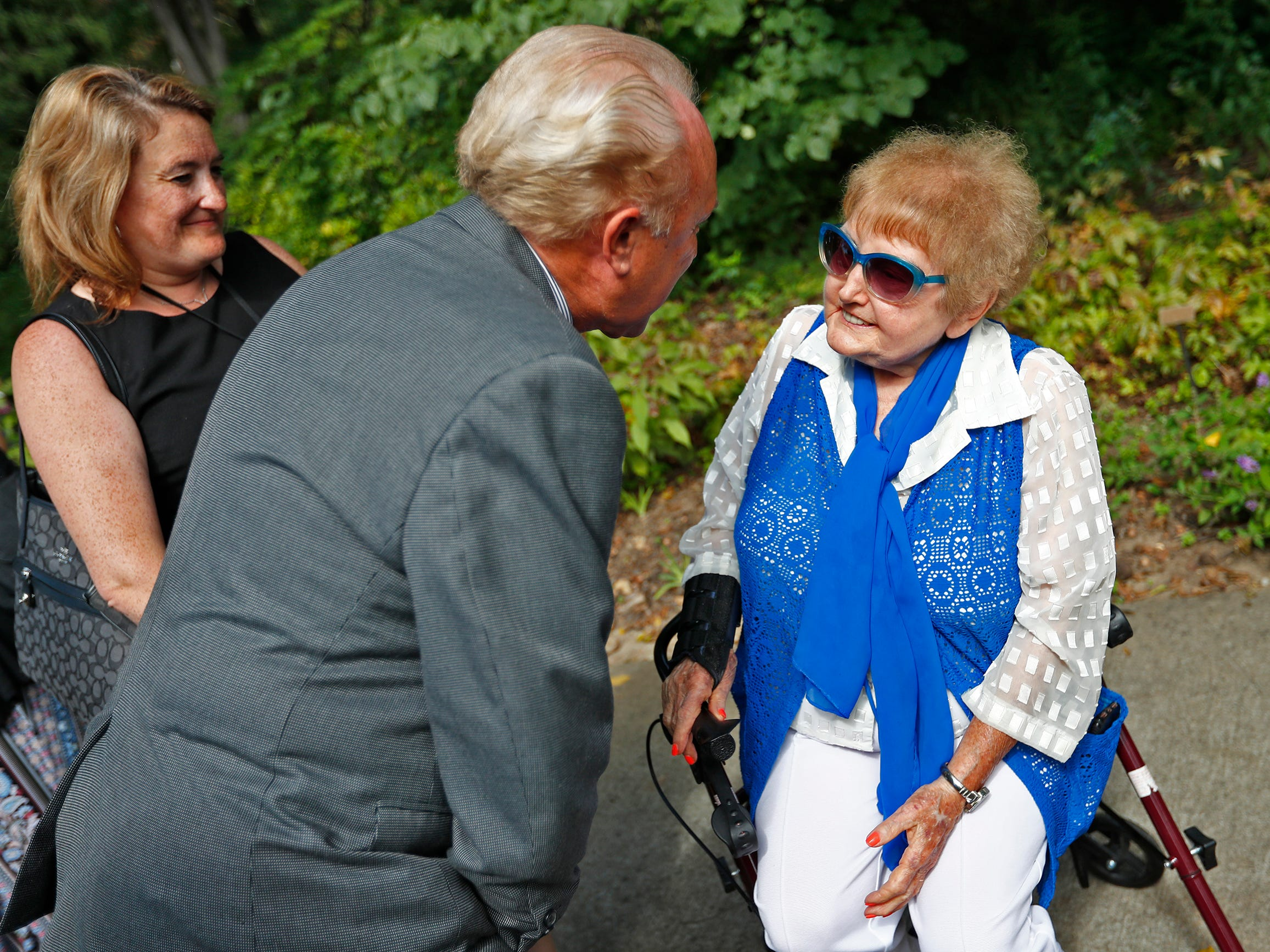 """Holocaust survivor Eva Kor, right, speaks with Heartland Film President Craig Prater during the planting of the Eva Kor Peace Garden at Newfields, Monday, Sept. 17, 2018.  Students viewed the documentary """"Eva,"""" about Kor, and then helped in the planting of the Peace Garden.  Kor also spoke with the students, asking them to think of one thing to make the world better."""
